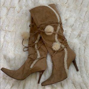 Tan heeled snow bunny boots with Pom poms